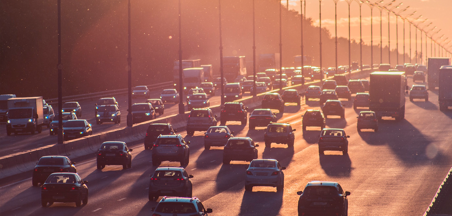 photo of highway traffic with sunset