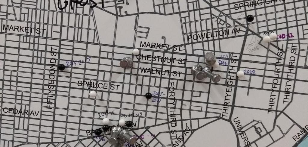 Section of a map of Philadelphia with pushpins inserted