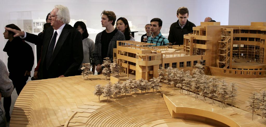 Richard Meier with students, wooden model in foreground