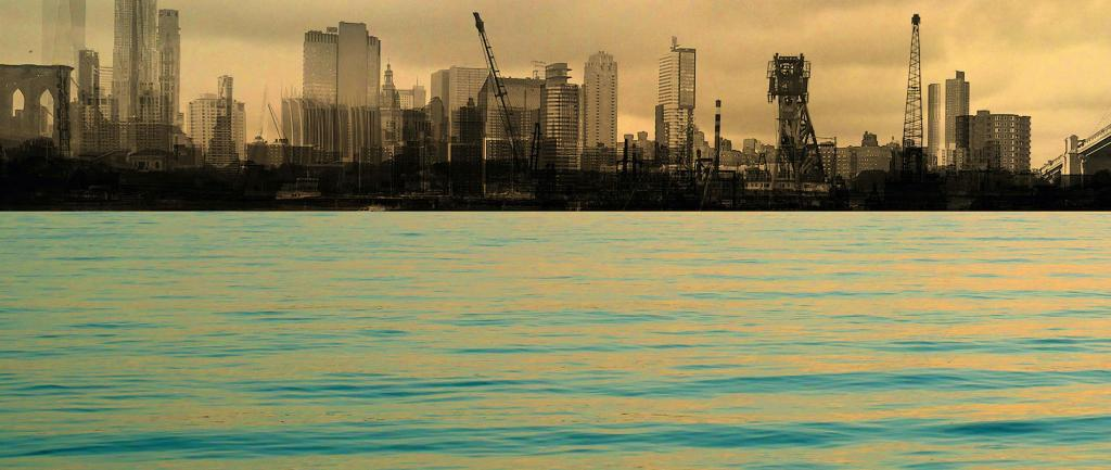 a large body of water with a city skyline in the background.