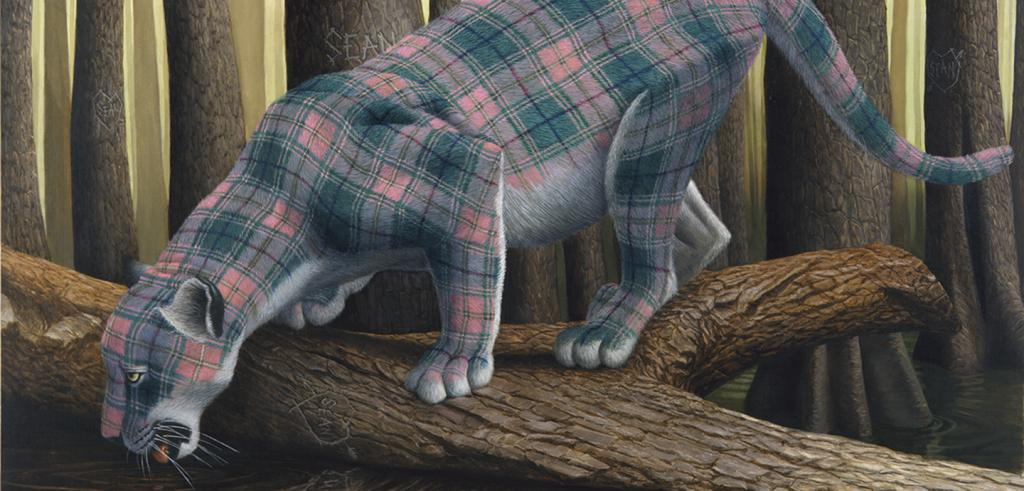 Plaid jaguar standing on a log in the forest.