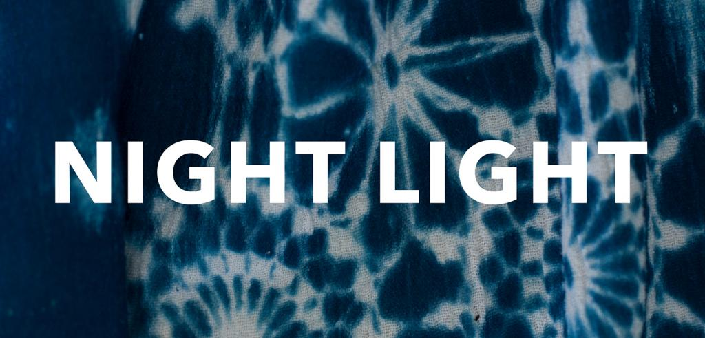 Blue and white tie die circle image with the words 'NIGHT LIGHT' written in white.