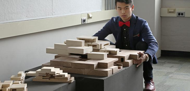 Andrew Wong (B.Arch. '18) presents his project during first-year design reviews.