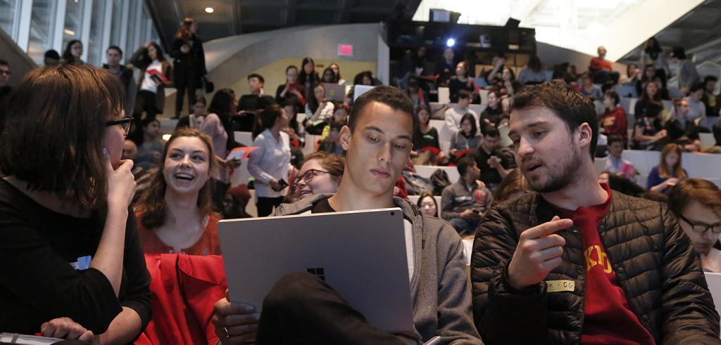 Students in Abby and Howard Milstein Auditorium