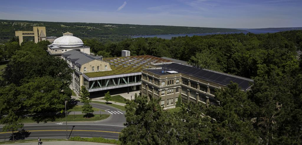 Exterior view of Sibley, Milstein and Rand Hall overlooking Cayuga lake.