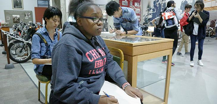 Students sketching at the museum with Gregory in foreground