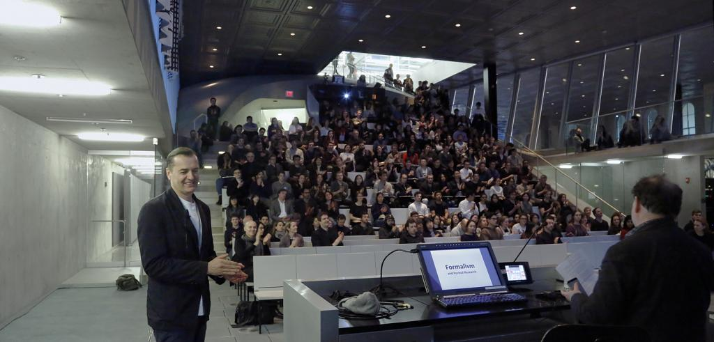 Patrik Schumacher in front of a crowded auditorium