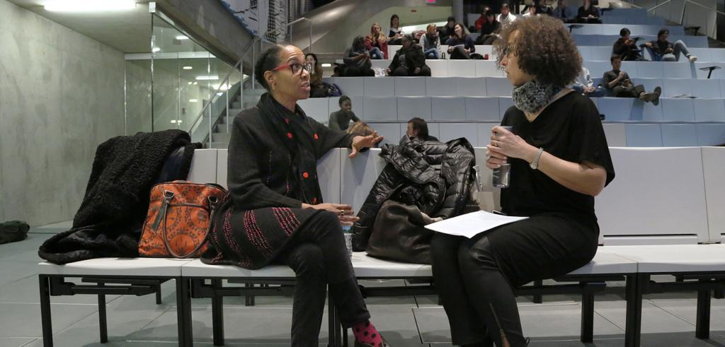 Sonya Clark speaks with Cheryl Finley in the auditorium before her lecture.