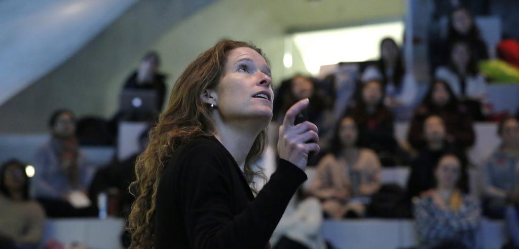 Susan Fleming lectures in front of a crowd