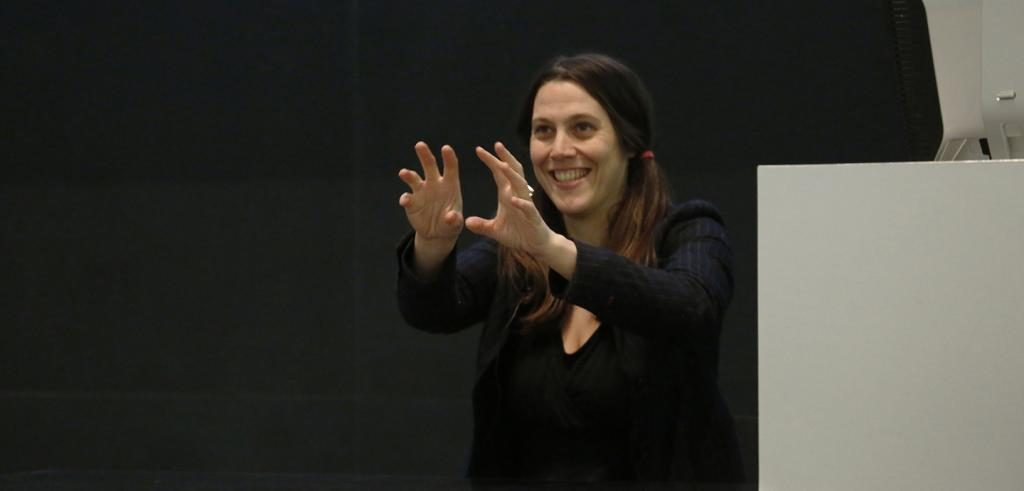Anna Huff smiling during her lecture