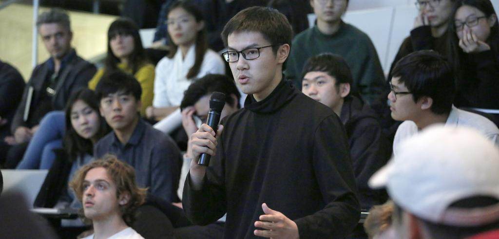 student asking a question during a Q&A session
