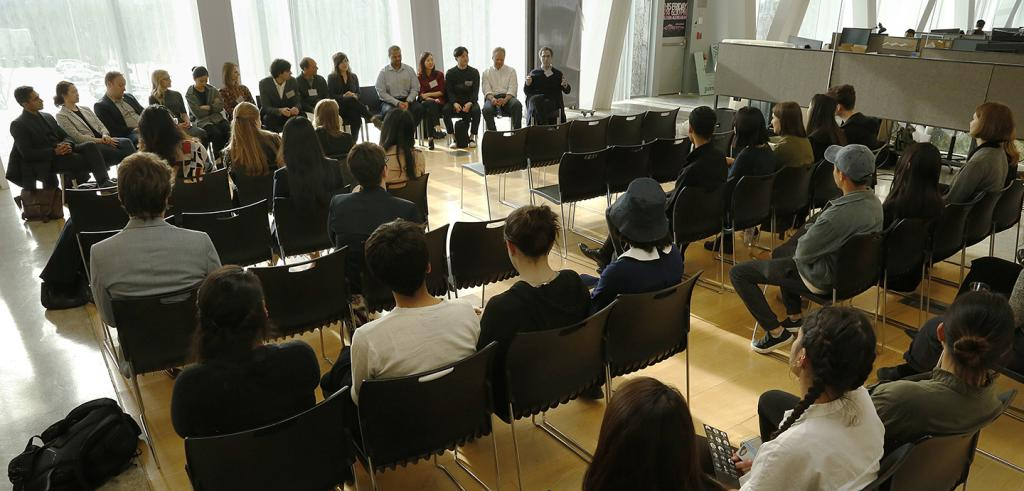 students and alumni seated at panel discussion in L. P. Kwee studios at AAP