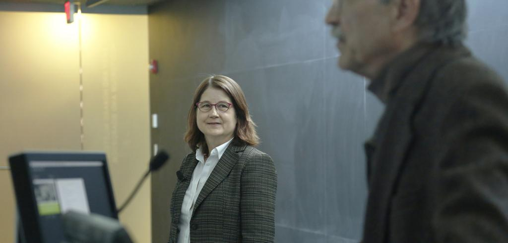 Kristin Larsen in the background with her introducer Michael Tomlan in the foreground.
