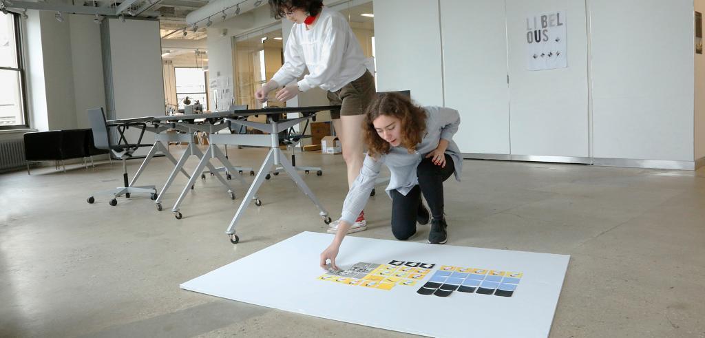 Two young women working in an art studio
