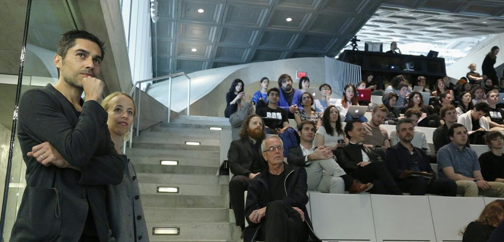 Mauricio Pezo and Sofia von Ellrichshausen in front of an audience in a stepped auditorium
