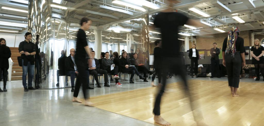 People in motion on a wooden floor