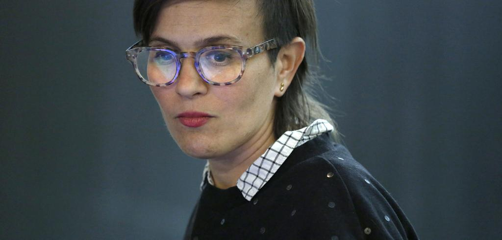 headshot of a woman in glasses