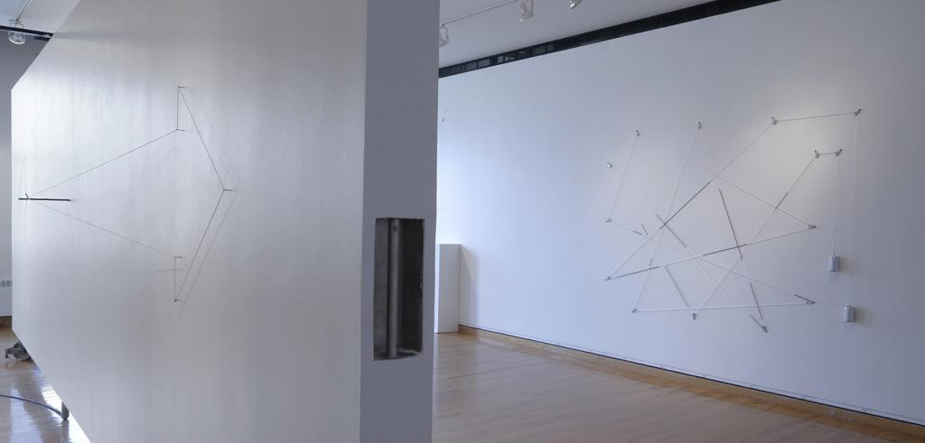 Gallery walls with string sculpture installations.