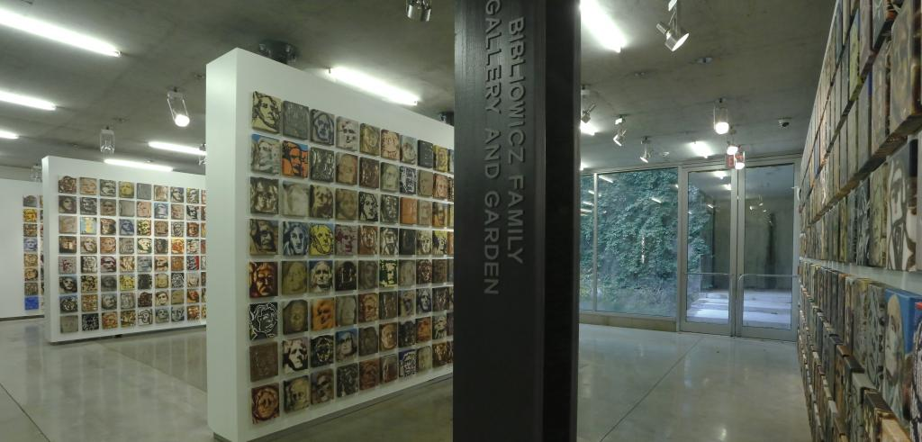 A view of a gallery with small images of faces.