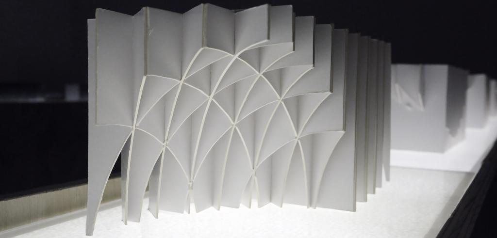 white cardboard model lit from below.
