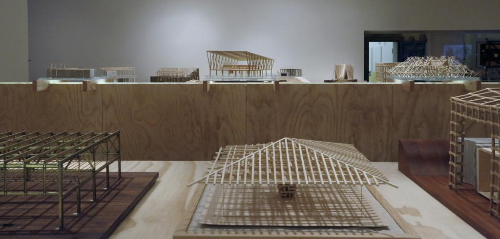 Architectural models made of wood displayed in a gallery