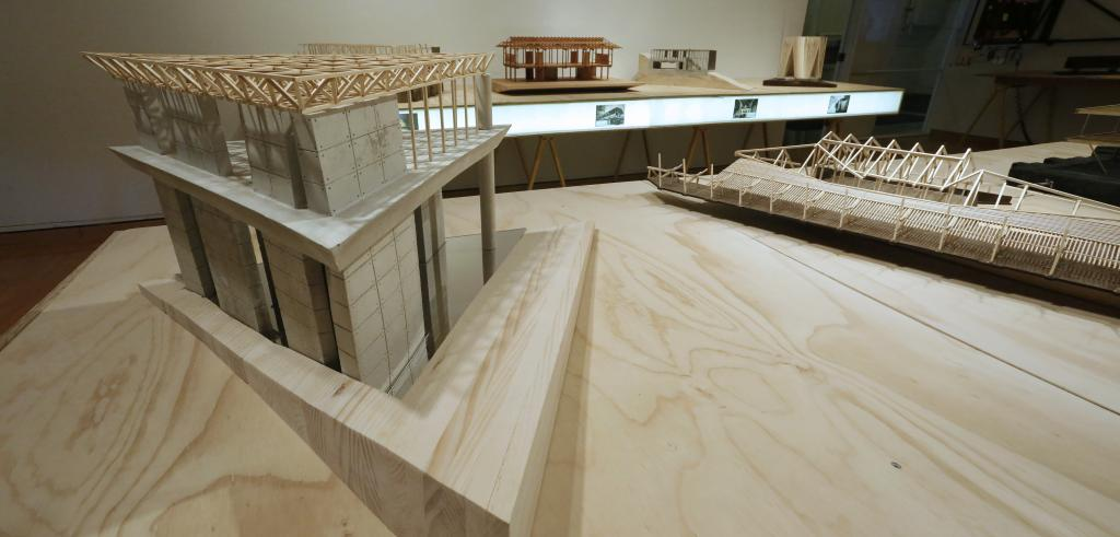 A wood and concrete model in a gallery