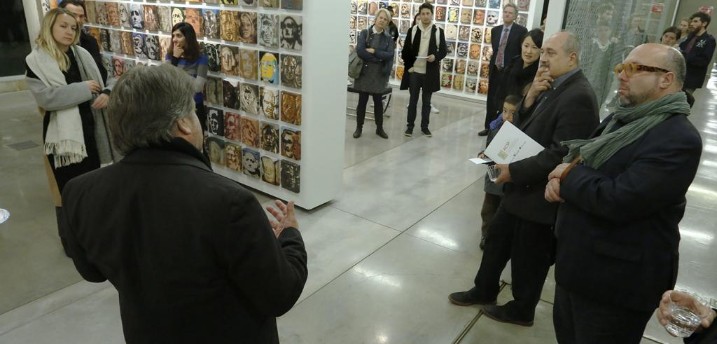 A group of people gathered in an art gallery.