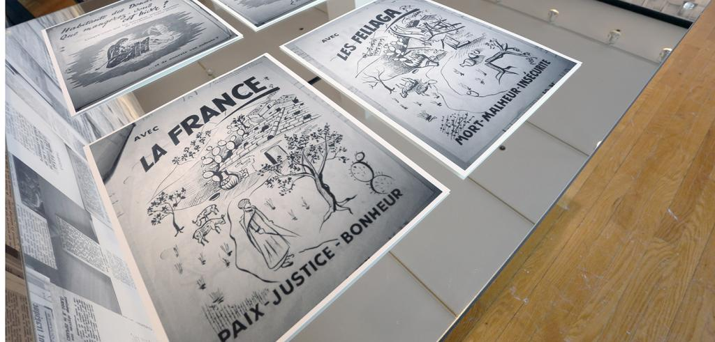 images on paper placed on a mirrored table