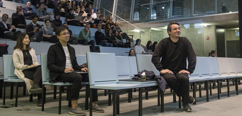 People sitting in an auditorium.
