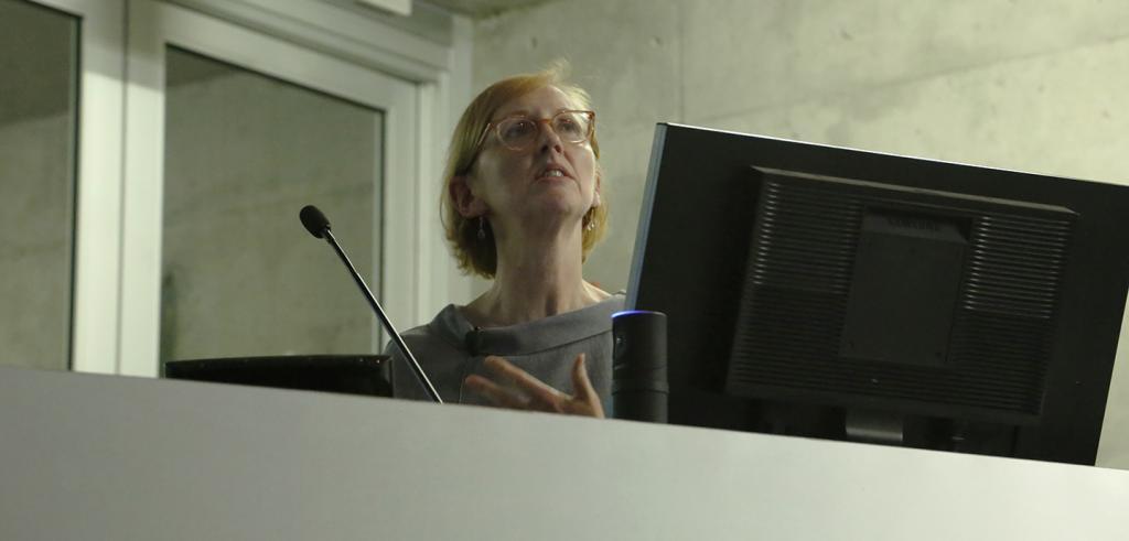 Woman speaking at a podium