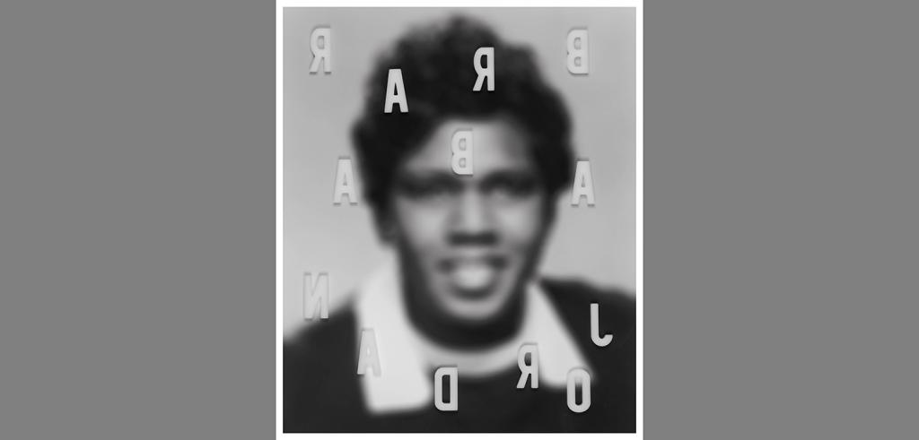black and white blurry photo of a man with Barbara Jordan written backwards over it