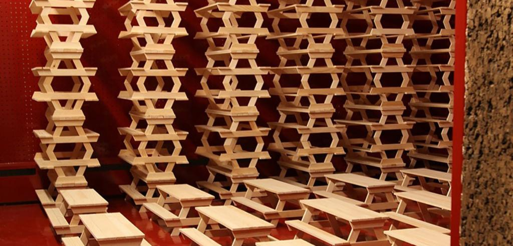 Stacks of picnic tables, red floor and walls