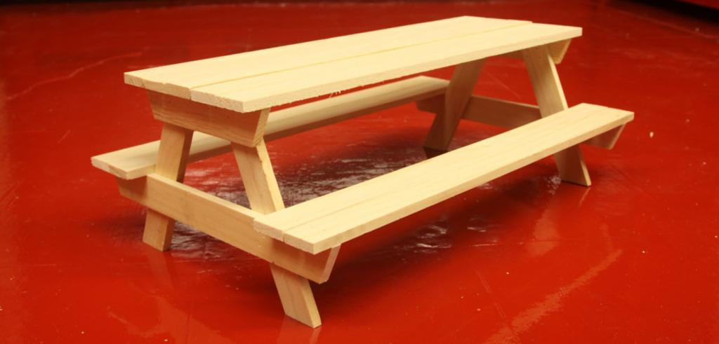 Single picnic table on red floor
