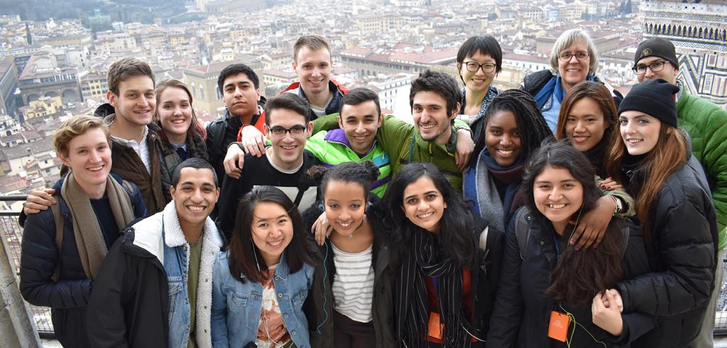 A group of students with the city of Florence, Italy, in the background.
