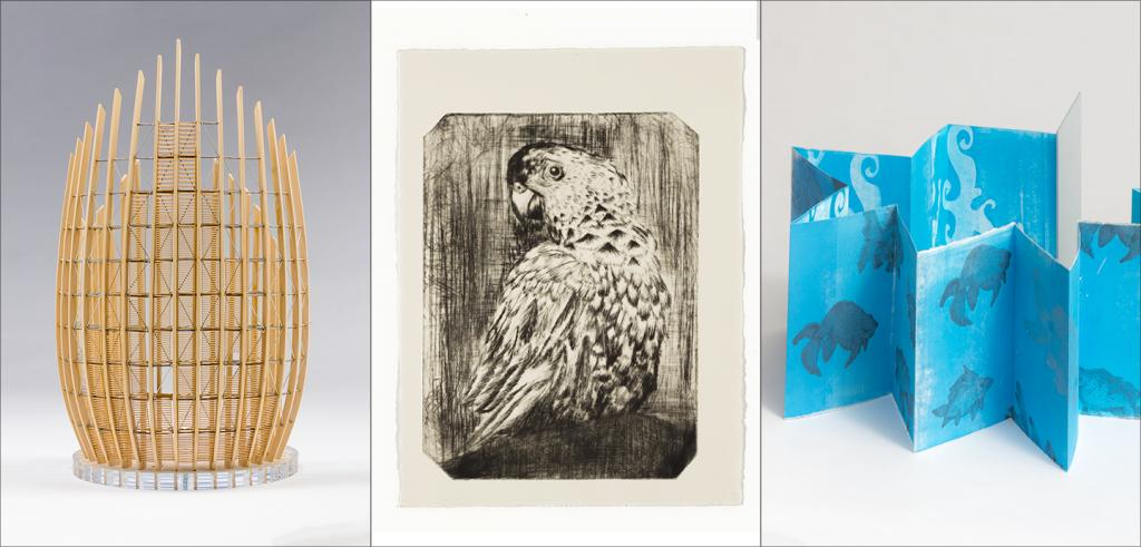 a wooden oblong model, a black and white image of a parrot and a blue folded piece of paper standing on its edge