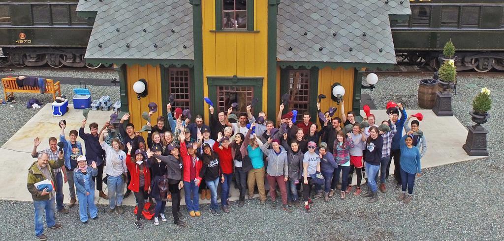 students cheering at a historic railroad station
