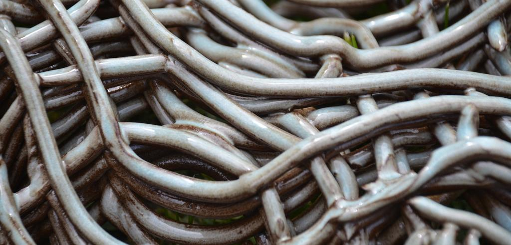 glazed clay strands woven together