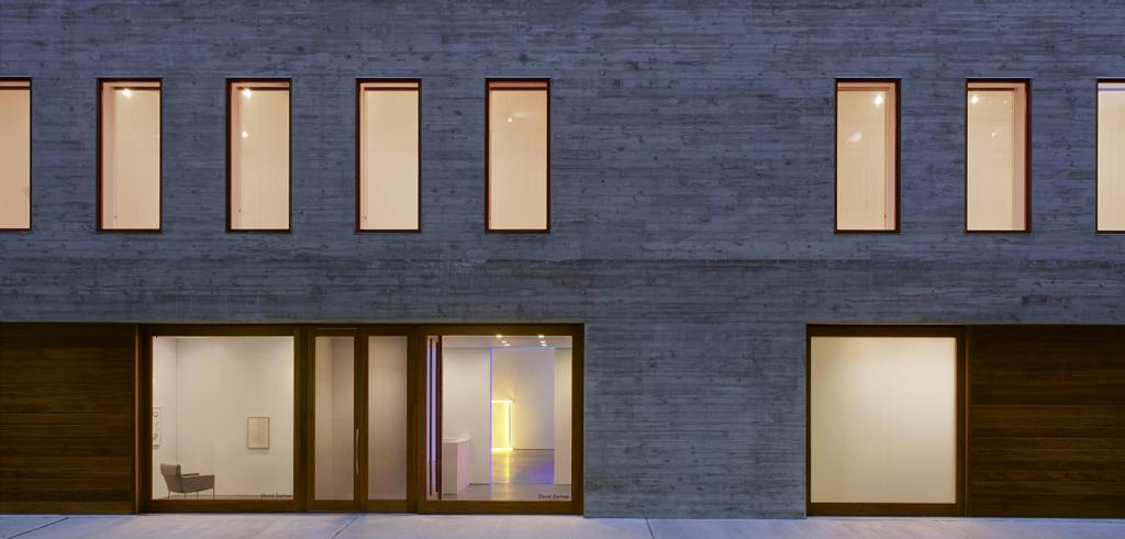 a building exterior with windows lit from within
