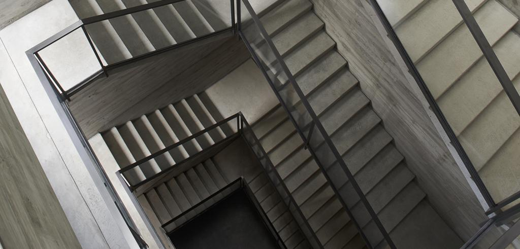 a gray concrete and metal stairwell