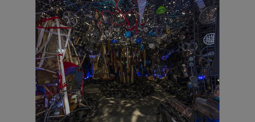 Miscellaneous items clustered together to create a cave, wires, lights, plastic parts.