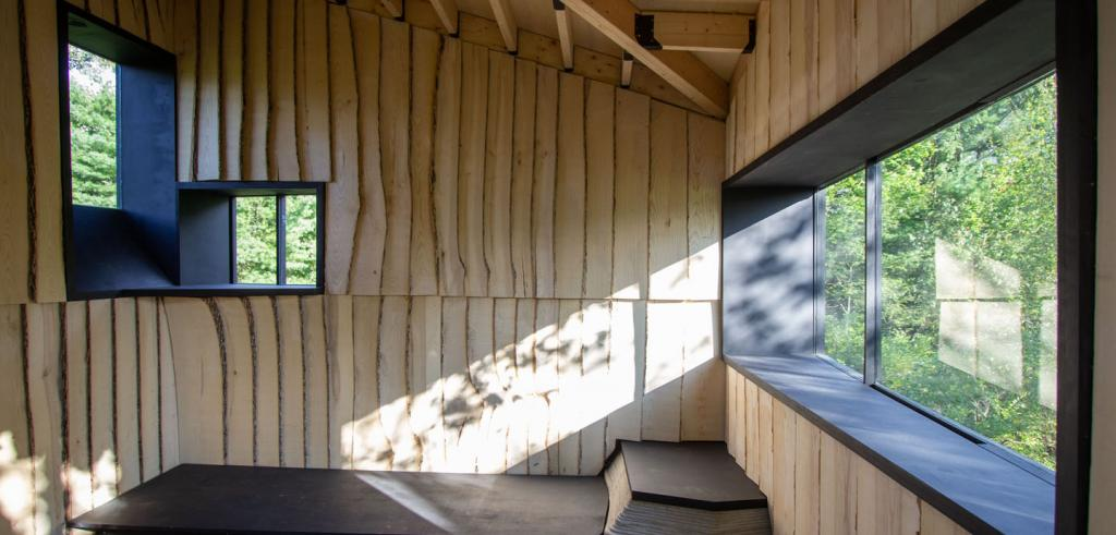 Window frame and undulating wood surface