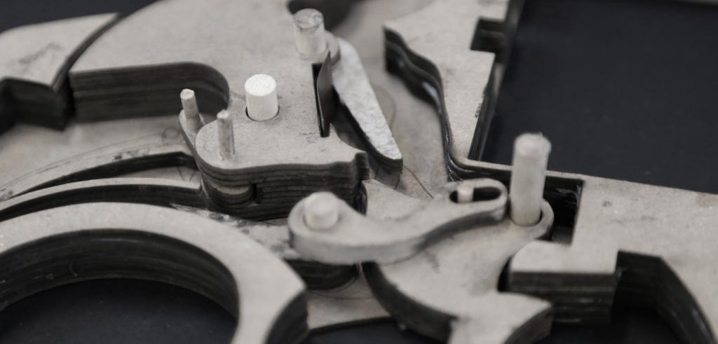 detail of a cardboard gun showing the firing mechanism up close