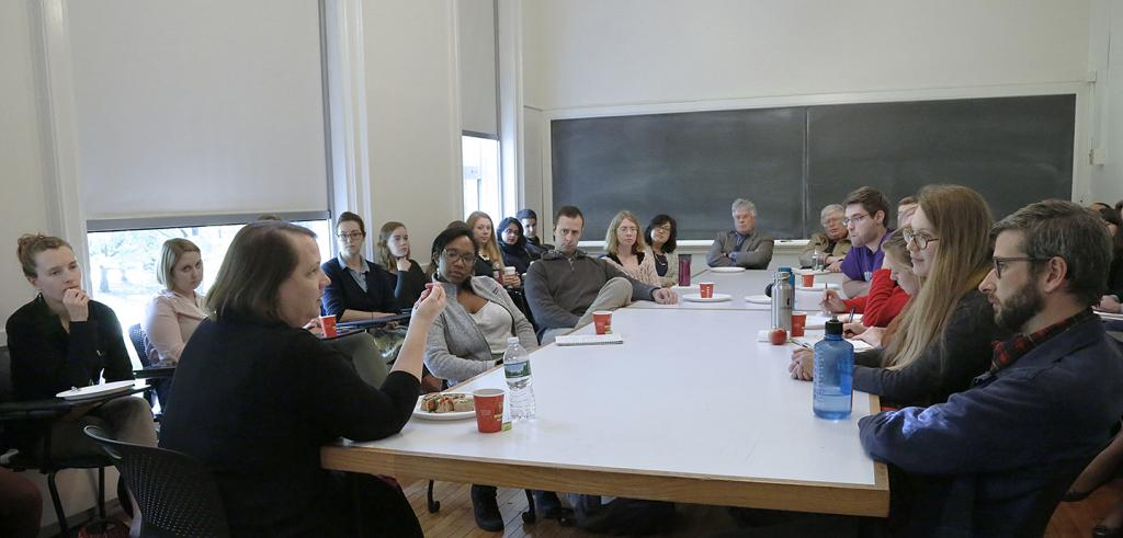 Lecturer Trudi Sandmeier speaking with a group of students and alumni at a talk balk session