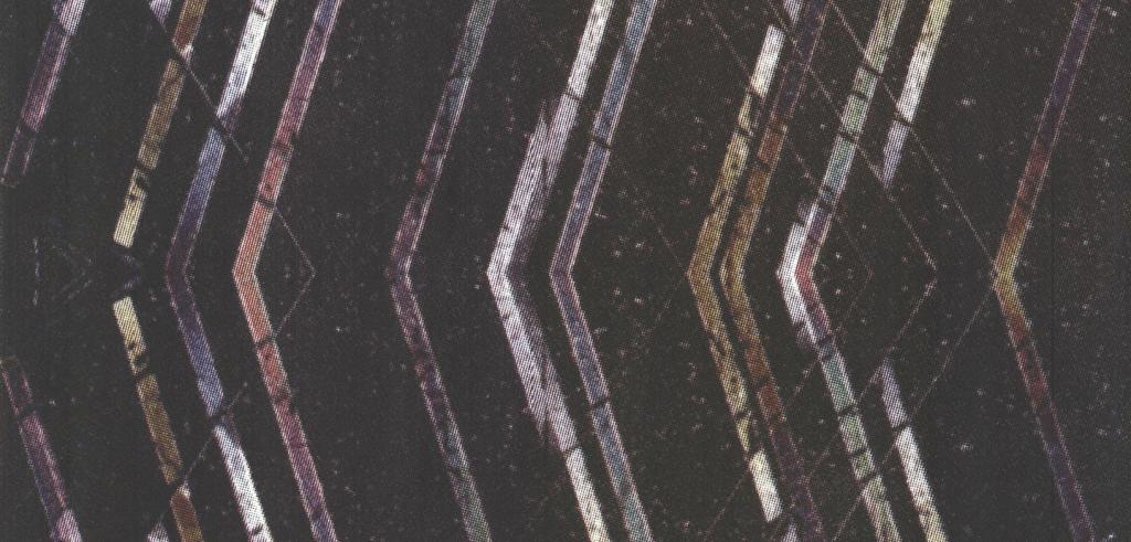 Various pointed lines against a dark speckled background.