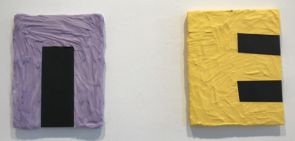 One painting of thick light purple paint with a black box in it, another painting of thick yellow paint with two black boxes in it.
