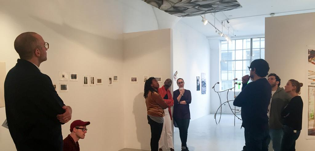 M.F.A. students with Teiger Mentor, Sean Landers, in a gallery space.