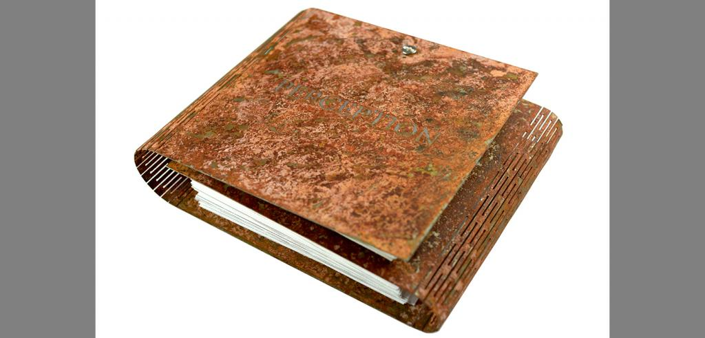 A book with an interleaved brown cover stamped with the word perception