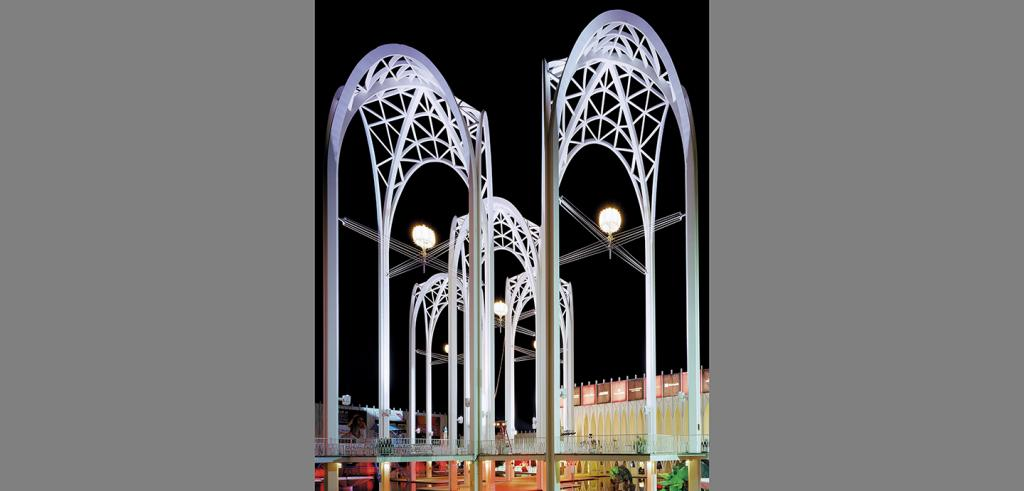 Lighted arches against a night sky