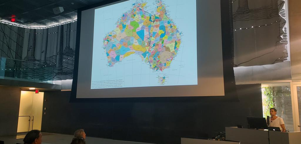 a colored map of Australia displayed in an auditorium