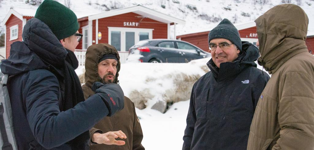 Four men discussing architecture in Norway in winter